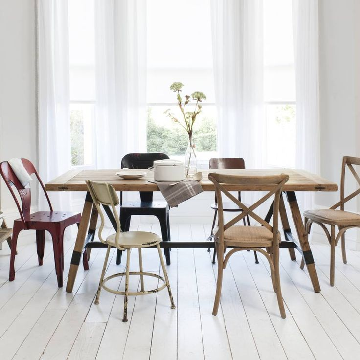 Industrial Dining Table with mismatched chairs