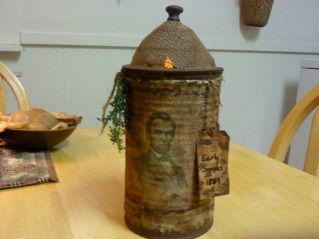 "Prim ""Lantern""...made from a pineapple juice can & an old sink screen...put a grungy battery operated candle inside & wrap with stained burlap or muslin & a hand tag."