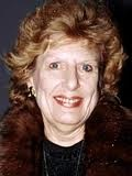 """Nancy Marchand -- (6/19/1928-6/18/2000). American Actress. She portrayed Margaret Pynchon on TV Series """"Lou Grant"""", Irene Kimbalt/Therrese LaMonte on """"Another World"""", Livia Soprano on """"The Sopranos"""". Movies -- """"Me, Natalie"""" as Mrs. Miller, """"Once Upon a Family"""" as Mrs. Demerjian, """"Brain Donors"""" as Lillian Oglethorpe, """"From the Hip"""" as Roberta Winnaker, """"The Naked Gun:From the Files of Police Squad!"""" as Mayor, """"Sabrina"""" as Maude Larrabee. She died from Lung Cancer & Emphysema, age 71."""