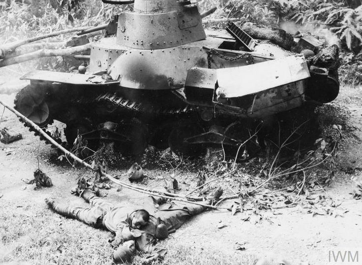 1942 - Dead Japanese lay next to their knocked-out Type 95 Ha-Go tank at a roadblock across the Muar - Parit Sulong road, near Bakri in Malaya, 18 January 1942. Nine tanks were destroyed in this engagement by two 2-pdr anti-tank guns of 2/4th Australian Anti-Tank Regiment. The battle of Muar, which took place around the Gemensah bridge and the Muar River in Johore, was the last major engagement of the campaign.