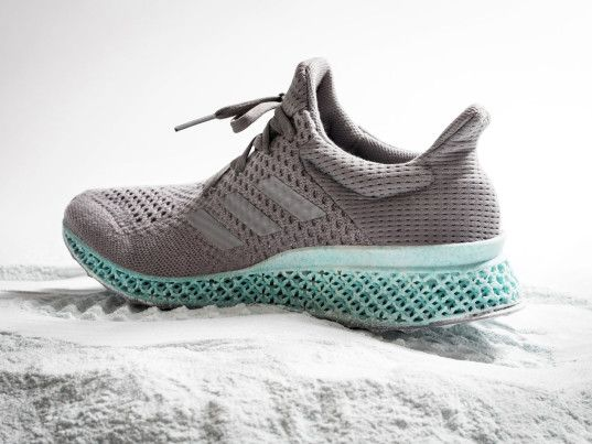 adidas printed ocean plastic shoe consists of an upper made with ocean  plastic content and a midsole made from recycle polyester and gill nets.