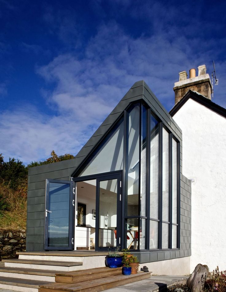 """The Sheiling by APD Architecture   Neil Taylor, Director of APD Architecture, comments: 'It is quite unusual to have achieved planning consent for such a contemporary house extension in this context. The design was made permissible through the use of a building form and a limited of palette materials that closely relate to the original building, and the lochside environment.'"""""""