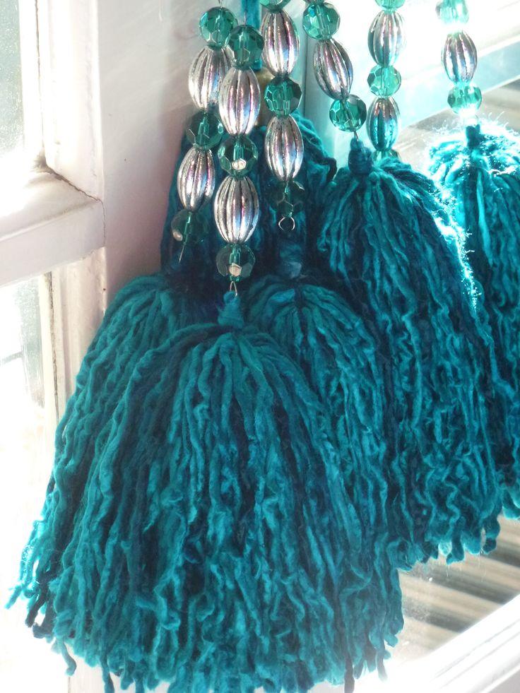 Borlas de lana, $60 en https://ofeliafeliz.com.ar