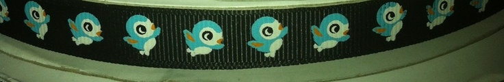 Up for sale are 13mm wide grosgrain ribbon, black baground and a blue bird.