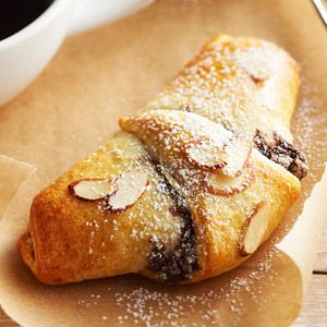 Dark chocolate, almond paste, and whipping cream make a rich filling for packaged crescent roll dough in this simple dessert.