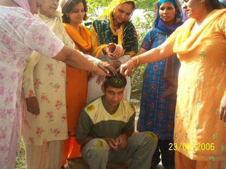 The ceremony of 'Haldi Rasm' on the marriage ceremony at bridegroom's house