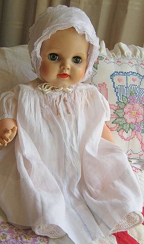 pretty vintage baby doll in vintage bay dress ,delicate with embroidery/ anybody know her name? i got one of her in the 50's and have her still, but do not know her original name.