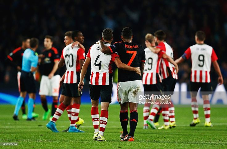 Santiago Arias of PSV Eindhoven and Memphis Depay of Manchester United embrace after the UEFA Champions League Group B match