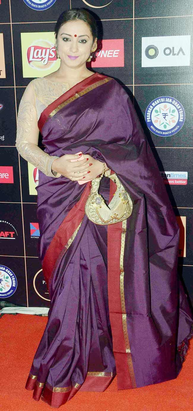 Divya Dutta in a traditional silk sari with a non traditional blouse