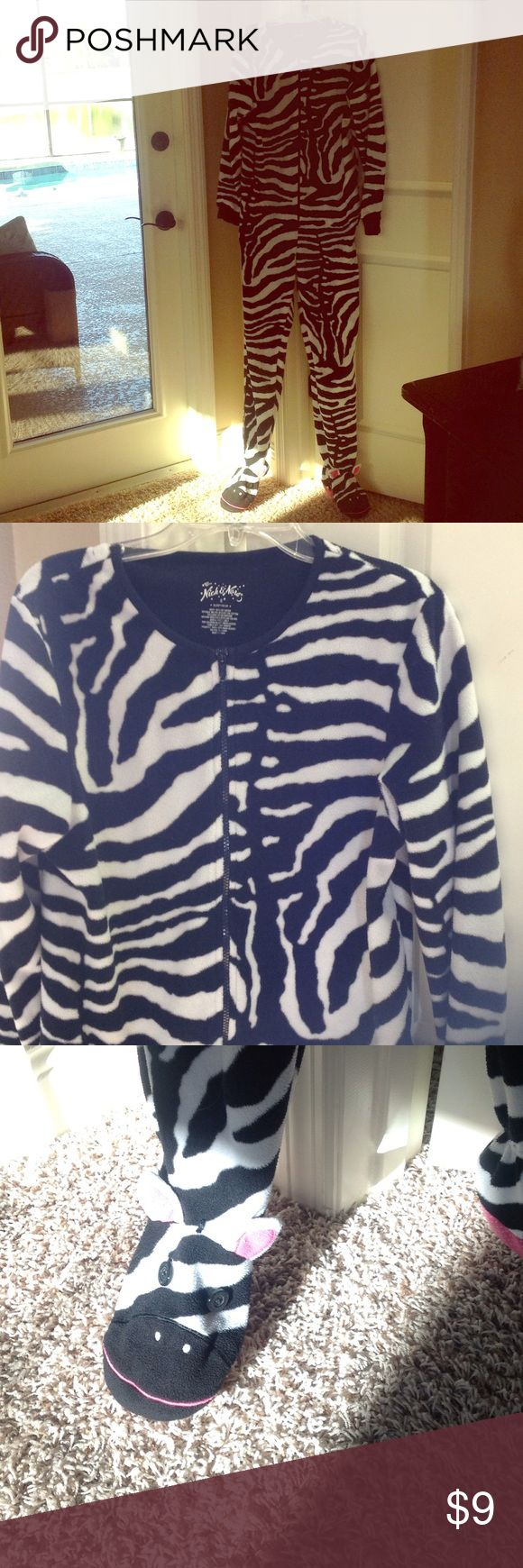 Nick and Nora one piece fleece sleeper, never worn Comfortable, cuddly, fleece. One piece zip up, onesie with zebra face on the feet. By Nick and Nora- good quality product. Size small. Never worn,  but washed (we live in florida 🌴). Nick and Nora Intimates & Sleepwear