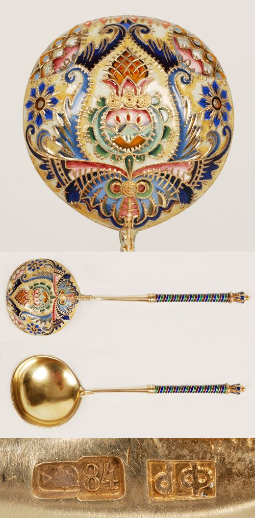 A Russian silver gilt and shaded cloisonne enamel spoon, Feodor Ruckert, Moscow, circa 1908-1917. The round bowl completely covered in polychrome floral and foliate motifs against a tan ground. Additional enamel designs on the spiraling handle and crown-shape finial