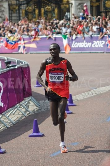 The 2012 Olympic Marathon Champion stephen Kiprotich of Uganda passes the 26 mile mark and enters the home straight.