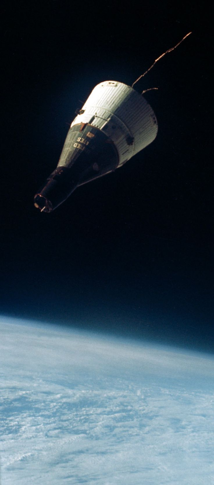 December 15, 1965 — The Gemini 7 spacecraft seen from the hatch window of the Gemini 6 spacecraft during rendezvous maneuvers about 160 miles above the Earth. (NASA)