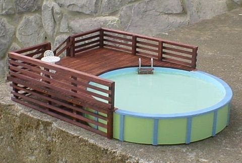 15 best images about pool decks on pinterest build a deck pools and above ground swimming pools for Swimming pools with built in tables