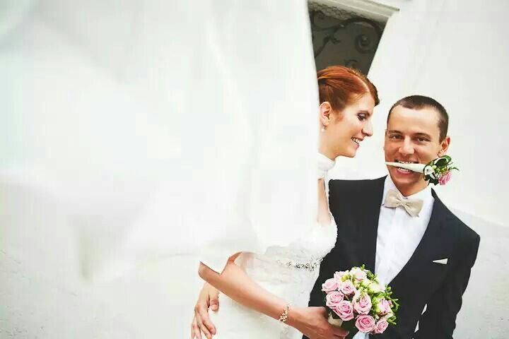 Wedding portraits. Hungry groom