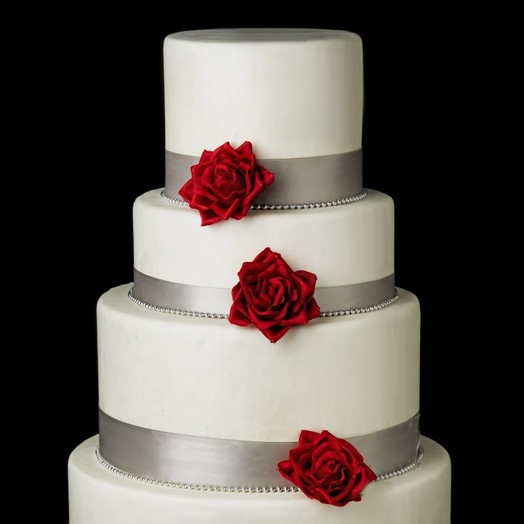 Red Rose Flower Clips decorate a white and silver four tiered wedding cake.