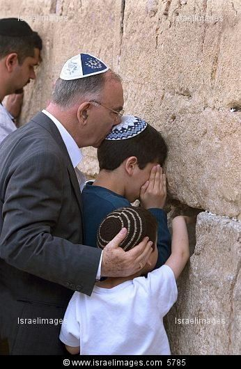 Father and sons at the Western Wall of Jerusalem.....this is serious and beautiful !