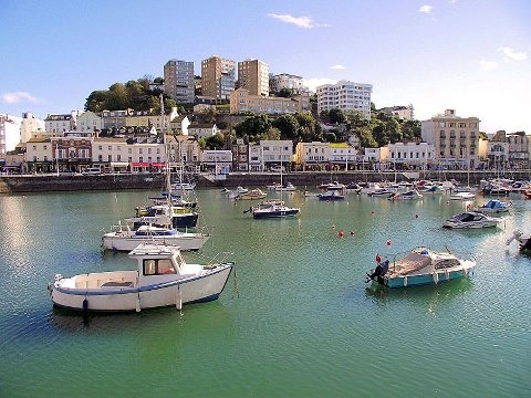 Torquay (pronounced Tour-key) is a seaside town located in south Devon. Part of the English Riviera, it was the home of Agatha Christie and Basil Fawlty. ;-)