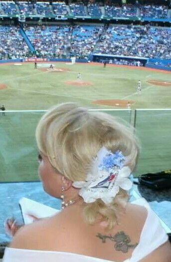 Blue jays themed vow renewal with half updo and bjs head piece diy