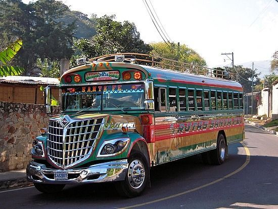 """A Guatemalan Chicken Bus. """"Chicken bus"""" is an English name for a colorful, modified and decorated bus that transports goods and people between communities in Guatemala. The main vehicle is usually a retired North American school bus on a light or medium truck chassis. The word """"chicken"""" refers to the fact that rural Guatemalans occasionally transport live animals. (The Vancouver Sun, by Tim Morrison)"""