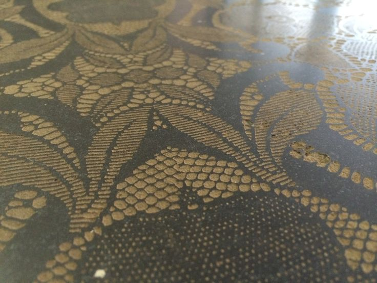 Lace effect  engraved on brown Stone