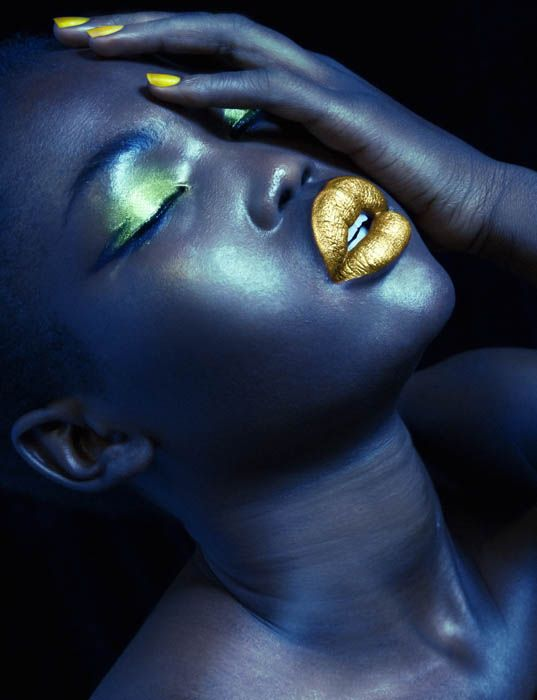 Check out this model Malaan Ajang, she is new and I love her exaggerated features i.e, slanted eyes, full lips and cheeks.