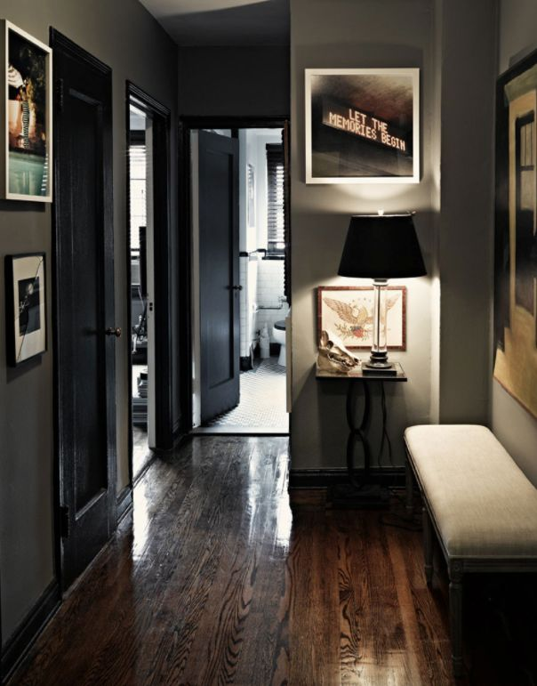 Wood floor, dark walls, and lots of pictures - alternative to white brick walls