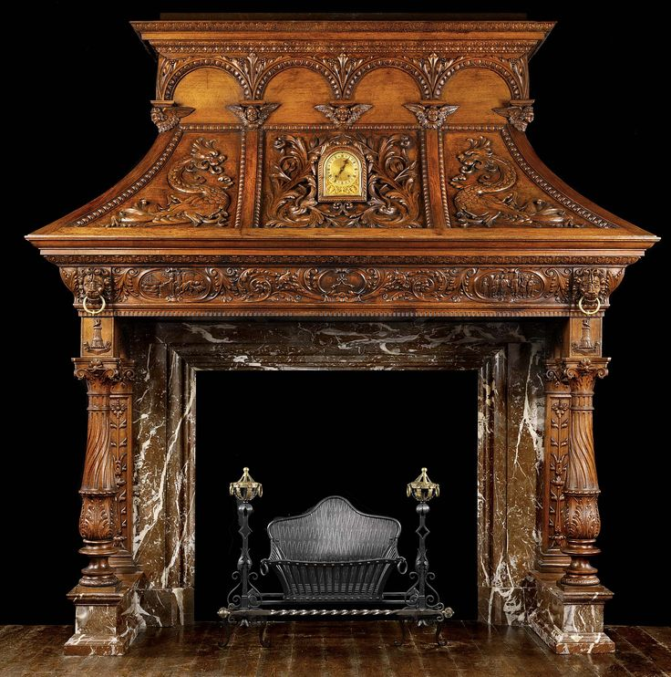 A very large and dramatically carved oak 19th century Chimneypiece in the 16th century Venetian Renaissance manner.