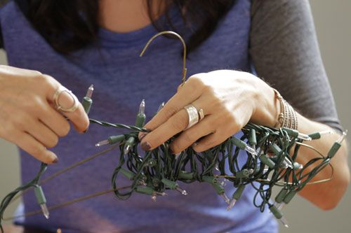 DIY Holiday Storage Tip: Wrap Christmas Lights Around Hangers >> http://blog.diynetwork.com/maderemade/2013/12/13/good-to-know-holiday-storage-tips-youll-love?soc=pinterest