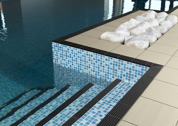 Luna pool surround and specialist step treads from the Dorset Woolliscroft collection. See more at designworkstiles.com.