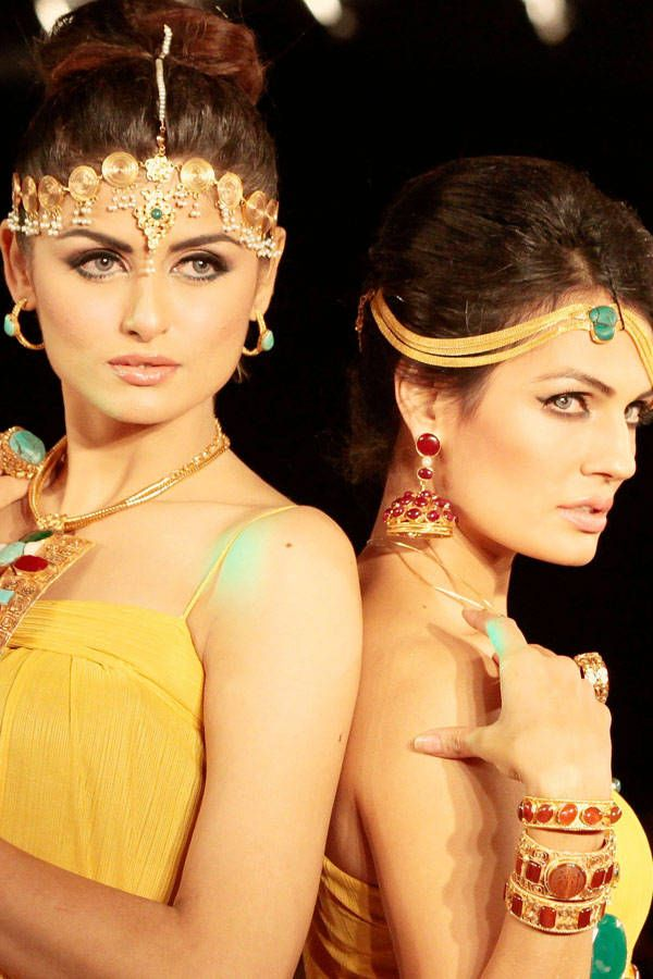 Models present creations by Pakistani designer Nosheen during the last day of Islamabad Fashion Week on October 6, 2013.