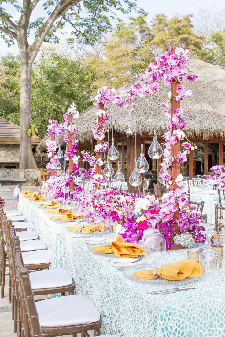 Special wedding party table décor with orchids arches centerpieces