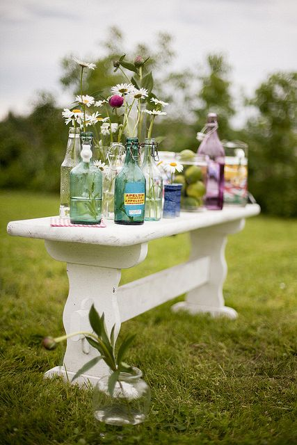 Summer flowers in second hand bottles  Photo: Karin Lindroos