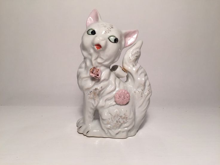 A personal favourite from my Etsy shop https://www.etsy.com/au/listing/280072004/vintage-kitsch-cat-kitten-salt-and