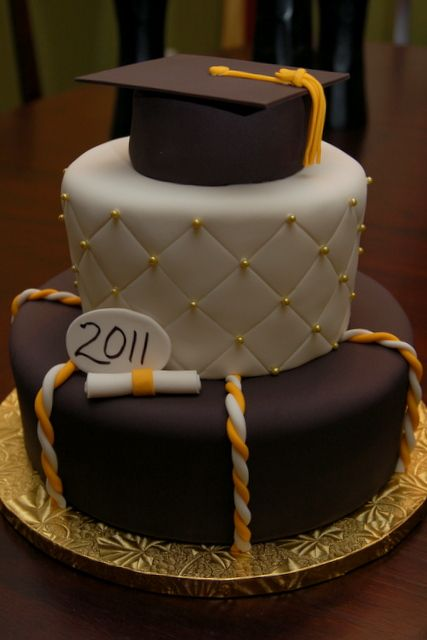 Montverde Academy Class of 2011 Graduation Cake (done in UCF colors) June 2011 3-layer cake with top layer styled as mortarboard with fondant tassel. Quilted fondant, gold-dust sugar pearls, and f...