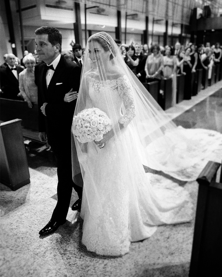 Everyone sees a glowing bride. As a mom I see a husband/dad trying to be brave as he gives away his little girl. A precious moment.