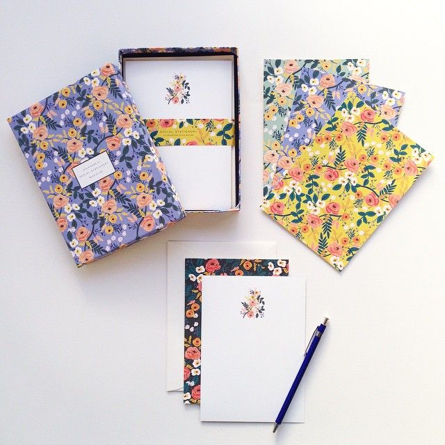 We have dozens of new products in the shop including our lovely new violet floral stationery set — visit riflepaperco.com to see more ;)