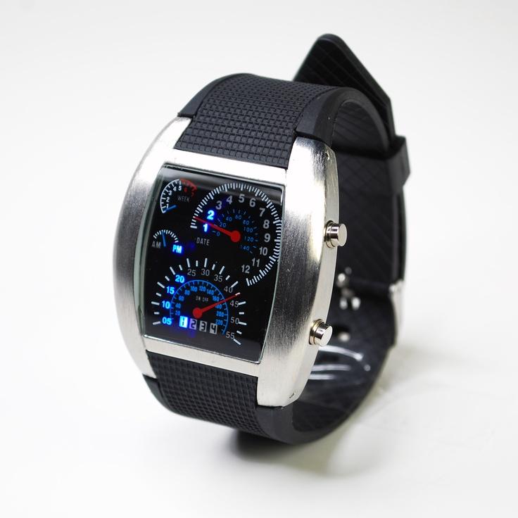 Das Ziffernblatt dieser originellen Uhr hat den Look eines Auto Dashboards. Zeit und Datum lässt sich vom Drehzahlmesser, Kilometerzähler, Geschwindigkeitsmesser und der Ölstands-Anzeige ablesen. Super Geschenkidee für Väter die ihr Auto lieben. http://www.megagadgets.de/rev-watch.html