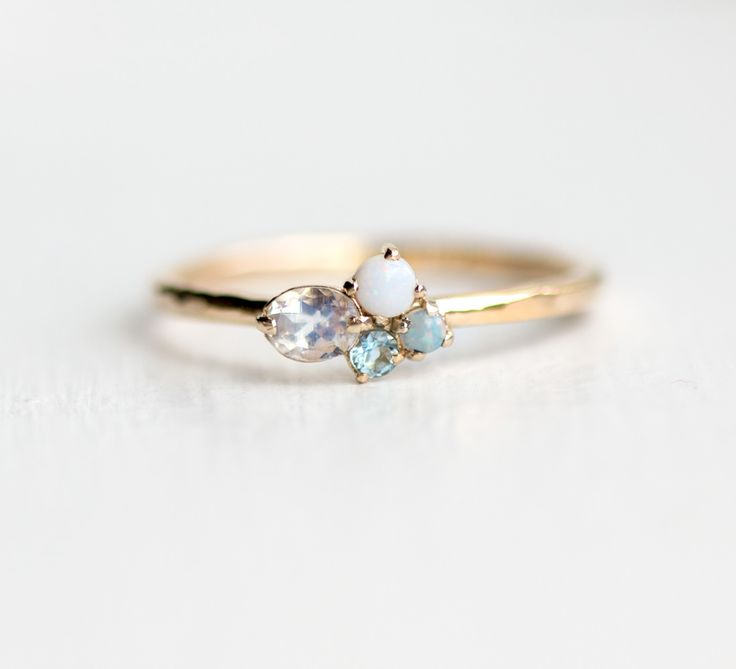 Custom mini cluster stacking ring in 14k gold. Build your own colorful gems on a solid 14k gold ring band. Shop our handmade collection now at Melanie Casey Jewelry.