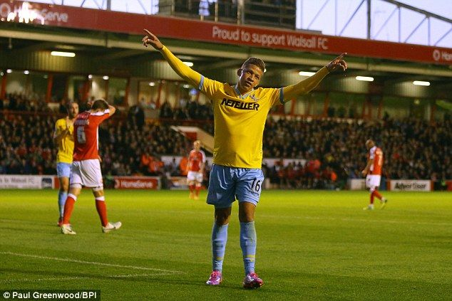 Walsall 0-3 Crystal Palace: Gayle celebrates in front of the away fans after completing his first-half hat-trick