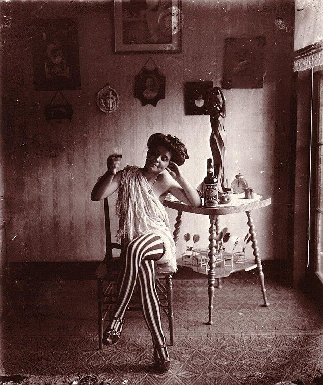 Haunting history: A series of intimate black and white photographs taken in 1912 by E.J. Bellocq reveal how prostitutes in New Orleans red-light district of Storyville lived more than a century ago