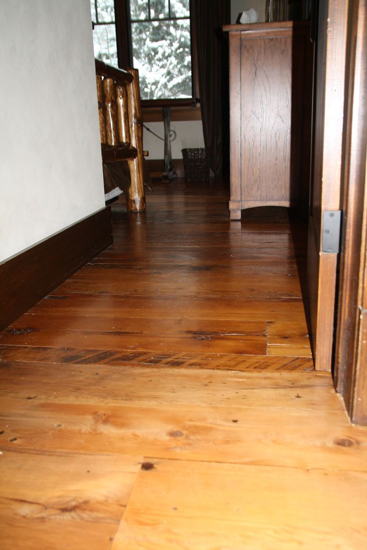 Refinished hallway adjacent to original Unrefinished flooring in study