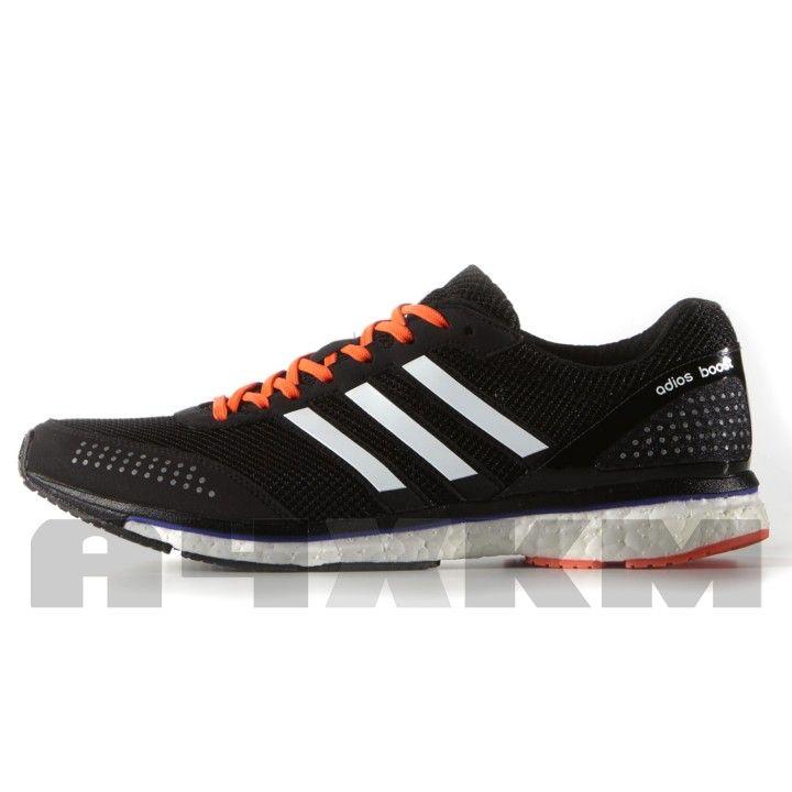 competitive price 6a268 31e14 Zapatillas voladoras para asfalto Adidas Adizero Adios Boost 2 en colores  negro, blanco y naranja para hombre. La media suela Boost propor…