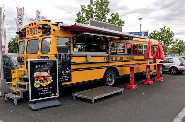 Used School Bus becomes a rolling restaurant /concession stand.                                                                                                                                                                                 More