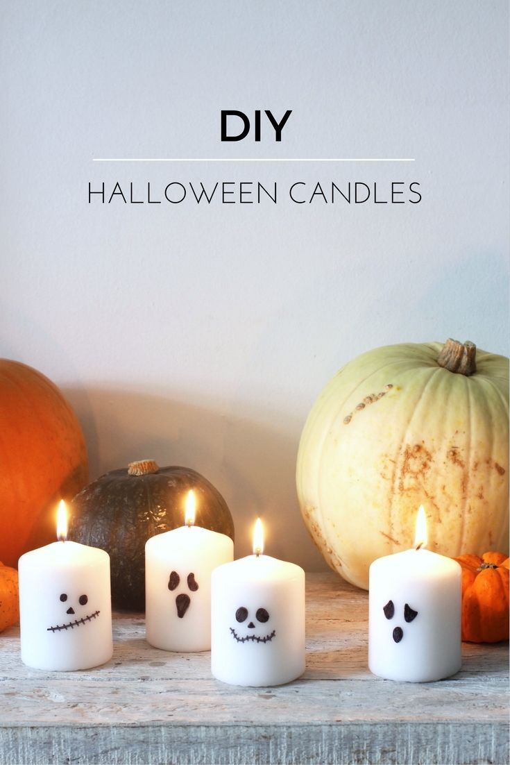 decorazioni Halloween: le candele fantasma - Super-easy halloween candles - all you need are candles and a Sharpie