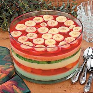 Six-Layer Gelatin Salad Recipe -This impressive salad does take some time to make, but the preparation itself is actually easy. It's an attractive addition to a buffet table. —Marcia Orlando, Boyertown, Pennsylvania