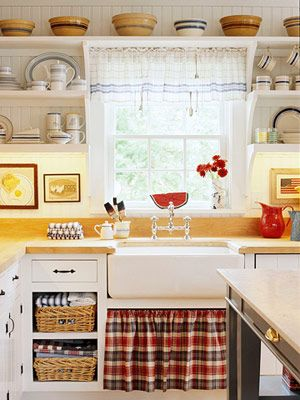 Open shelving and a skirted farmhouse apron sink. Love the pop of color the fabric adds!