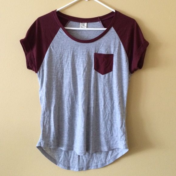 Zumiez tee shirt Gently used grey and maroon zumiez tee shirt with pocket. Size small. Brand Zine. Zine Tops Tees - Short Sleeve