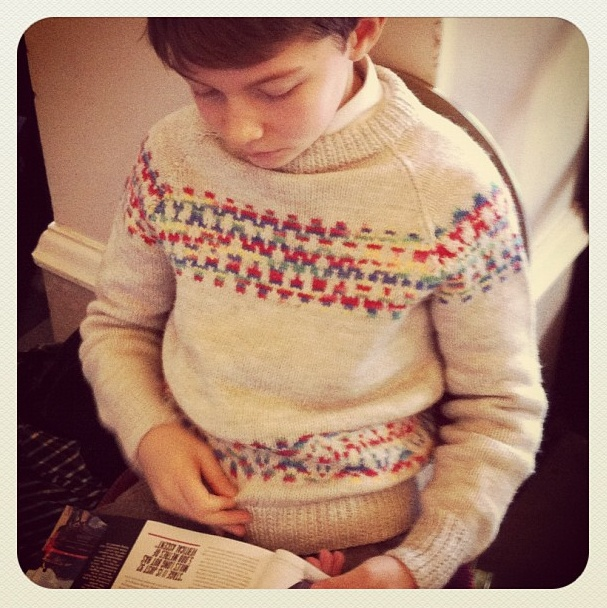 Sweet boy wearing lovely hand-knit (with our trousers and shoes!)