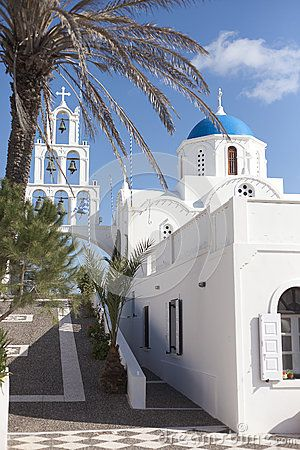 Blue domes of Santorini with bell tower and palm tree #oia #santorini #greekvillage #greece #bluedomes